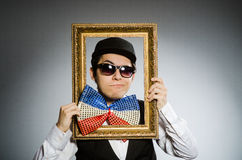 The funny man with picture frame Stock Image