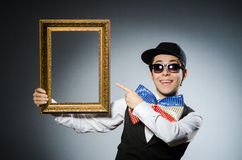The funny man with picture frame Royalty Free Stock Photos