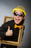 The funny man with picture frame Stock Photography