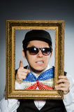 The funny man with picture frame Stock Images
