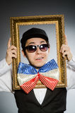 The funny man with picture frame Stock Photos