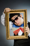 Funny man with picture frame Stock Photo