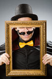 The funny man with picture frame Royalty Free Stock Image