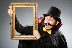 The funny man with picture frame Royalty Free Stock Photography