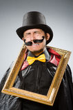 The funny man with picture frame Royalty Free Stock Photo
