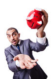 Funny man with piggybank Royalty Free Stock Photography