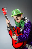 The funny man playing guitar in musical concept Stock Photo