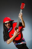The funny man playing guitar in musical concept Royalty Free Stock Photo