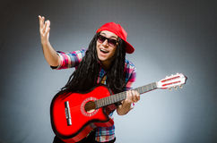 The funny man playing guitar in musical concept Royalty Free Stock Images