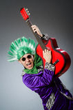 The funny man playing guitar in musical concept Royalty Free Stock Image