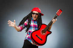 The funny man playing guitar in musical concept Royalty Free Stock Photography
