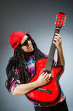 The funny man playing guitar in musical concept Stock Image