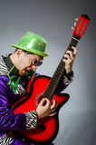 The funny man playing guitar in musical concept Stock Images