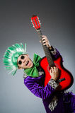 The funny man playing guitar in musical concept Royalty Free Stock Photos