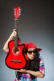 The funny man playing guitar in musical concept Stock Photos