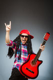 Funny man playing guitar in musical concept Royalty Free Stock Photo
