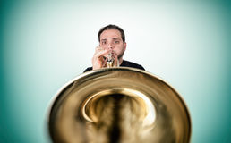 Funny man is playing trumpet Stock Photography
