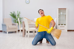 The funny man playing virtual guitar with broom Stock Images