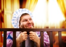 Funny man in playpen looking out Stock Photos