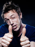 Funny Man Portrait winking thumb up Royalty Free Stock Photography