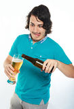 Funny man pouring beer Royalty Free Stock Images