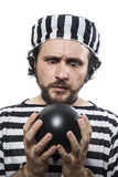 Funny man prisoner criminal with chain ball and handcuffs in stu Stock Photography