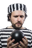 Funny man prisoner criminal with chain ball and handcuffs in stu Stock Image