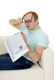 Funny man reading a job advertisement in newspaper Royalty Free Stock Photo