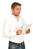 Funny man reading a paper Stock Photos