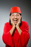 Funny man in red dress wearing Royalty Free Stock Photography