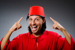 Funny man in red dress wearing Stock Photo