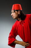 Funny man in red dress wearing Stock Photography