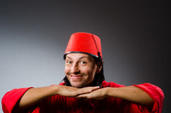 Funny man in red dress wearing Stock Image