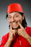 Funny man in red dress wearing Royalty Free Stock Photos