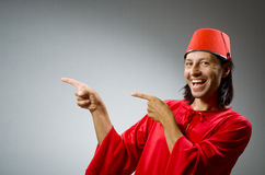 Funny man in red dress wearing Royalty Free Stock Images