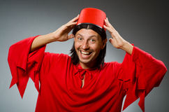 Funny man in red dress wearing Royalty Free Stock Photo