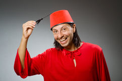 Funny man in red dress wearing Stock Images