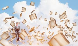 Young businessman or student studying the science and books fly around royalty free stock photo