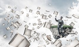 Young businessman or student studying the science and books fly royalty free stock image