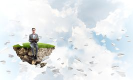 Young businessman or student studying the science and paper planes fly around royalty free stock images