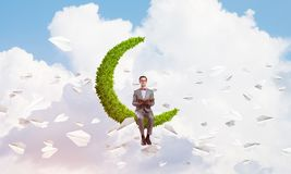 Young businessman or student studying the science and paper planes fly around stock images