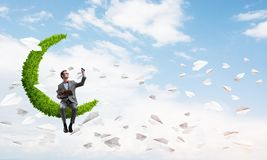 Young businessman or student studying the science and paper planes fly around stock image