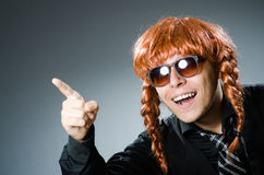The funny man with red hair wig Stock Photo