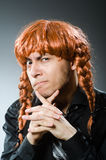 The funny man with red hair wig Stock Image