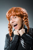 The funny man with red hair wig Stock Photos