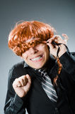 The funny man with red hair wig Royalty Free Stock Photos