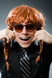 The funny man with red hair wig Royalty Free Stock Photography