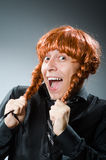 Funny man with red hair wig Stock Photos