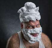Funny man with shaving foam covered face Stock Photo