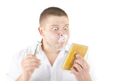 Funny man shaving in front of mirror. Isolated over white Royalty Free Stock Photos